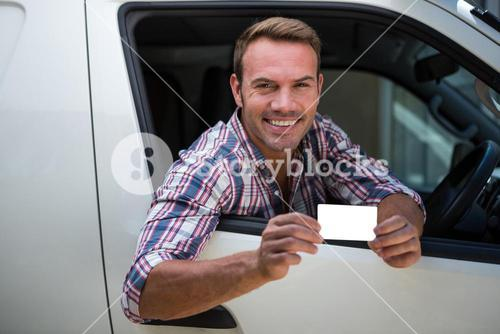 Young man showing his drivers license