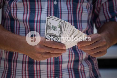 Man counting currency note