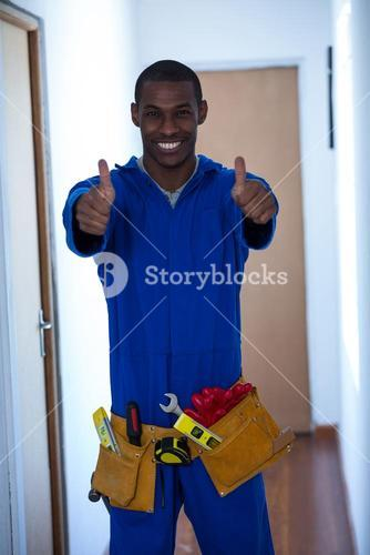Happy handy man showing his thumbs up