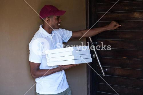 Pizza delivery man with pizzas boxes