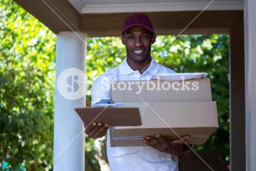 Happy delivery man with parcel