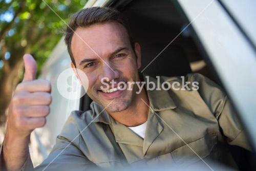 Delivery man sitting in his van