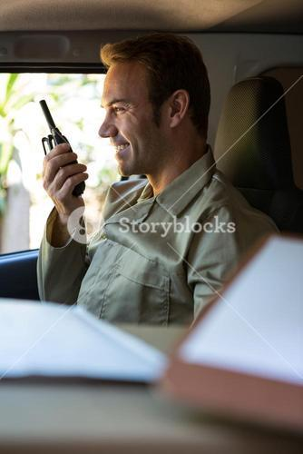 Delivery driver talking on walkie-talkie