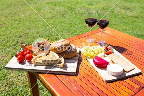 Fruit, bread and wine glass on wooden table