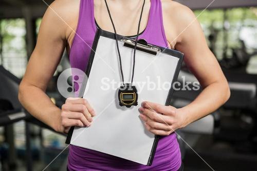 Trainer holding clipboard