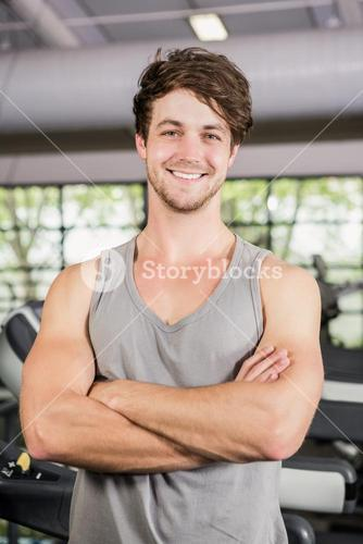 Handsome man standing in gym