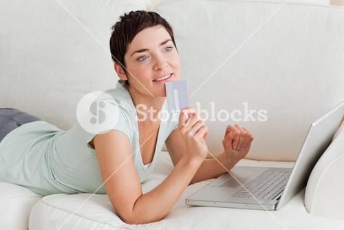Pensive woman buying online