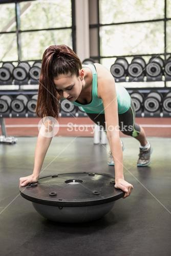 Woman working out with bosu ball