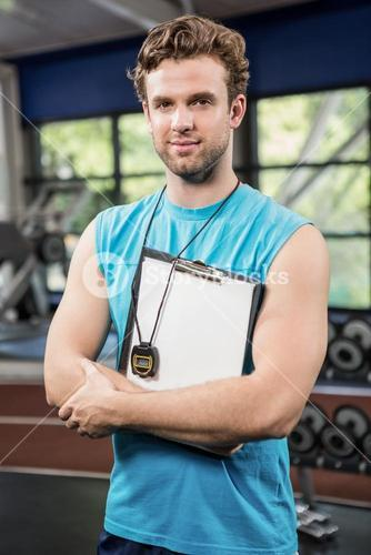 Gym instructor holding clipboard