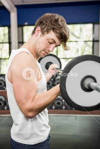 Man lifting a heavy barbell