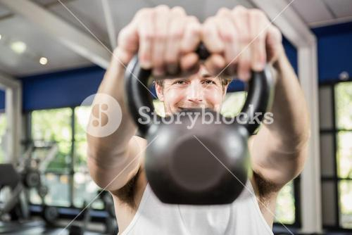 Man looking through kettlebell