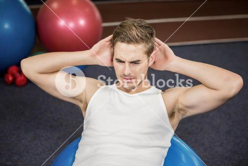 Man working out on fitness ball