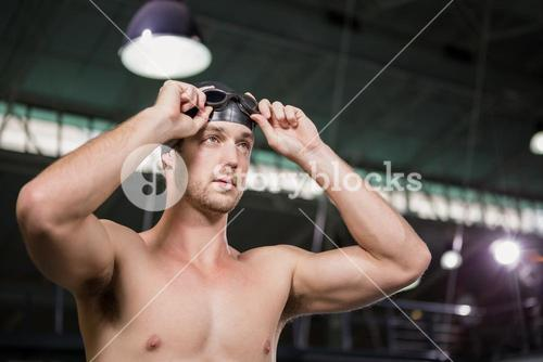 Swimmer wearing swimming goggles and cap