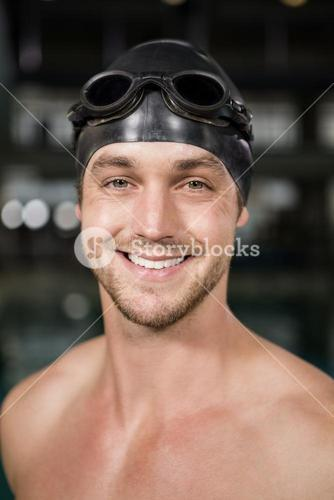 Portrait of swimmer wearing swimming goggles and cap