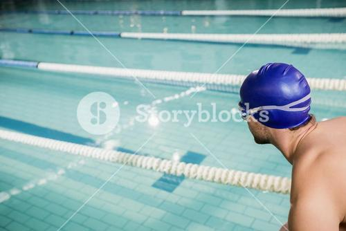 Swimmer about to dive into the pool