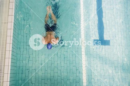 Swimmer doing the breaststroke in swimming pool
