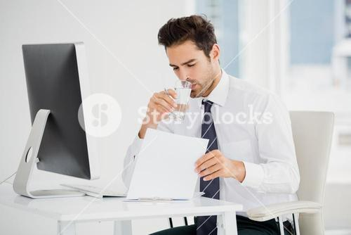 Businessman having a glass of water