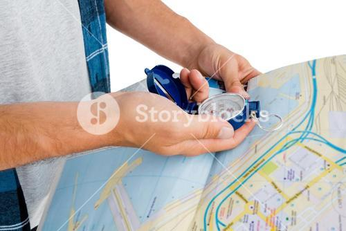 Man holding map and compass