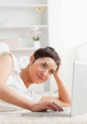 Portrait of a quiet woman relaxing with a laptop