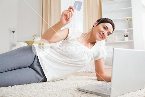 Brunette using her credit card to pay online