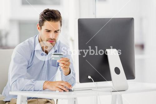 Businessman doing online shopping on computer