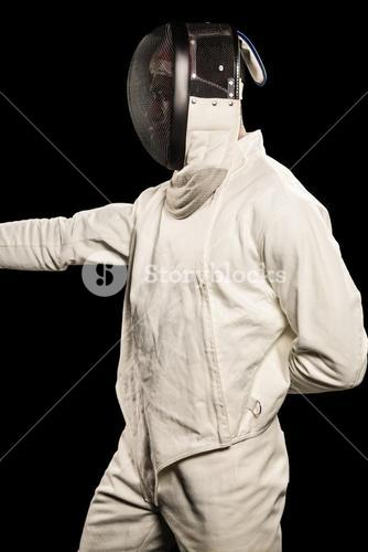 Man wearing fencing suit practicing
