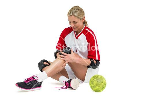 Sportswoman wearing a knee pad