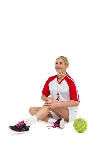 Sportswoman touching her knee