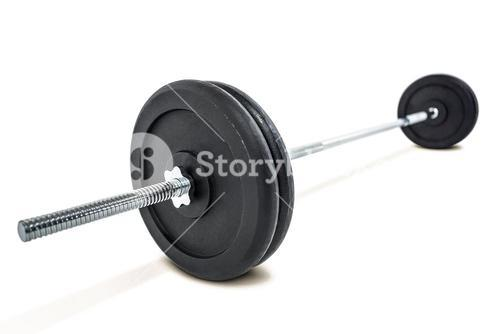 Barbell weights on white background