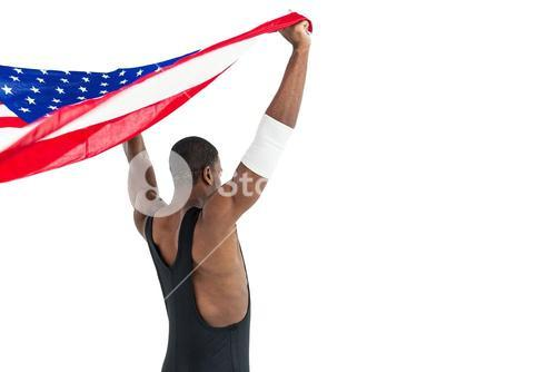Athlete holding american flag