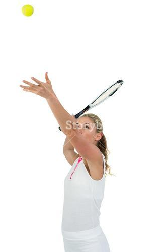 Athlete holding a tennis racquet ready to serve