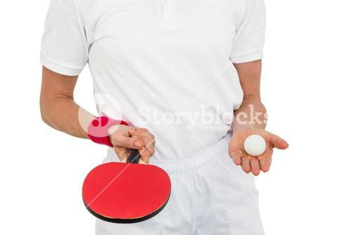 Female athlete holding table tennis paddle and ball