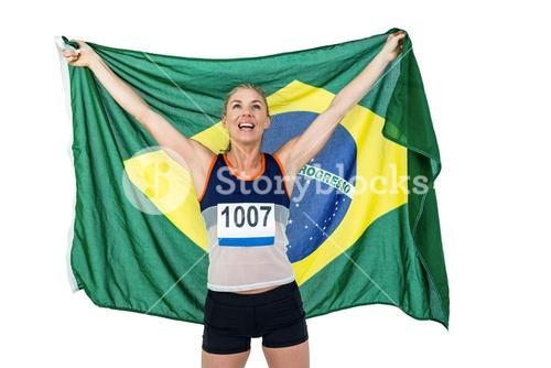 Athlete posing with brazilian flag after victory
