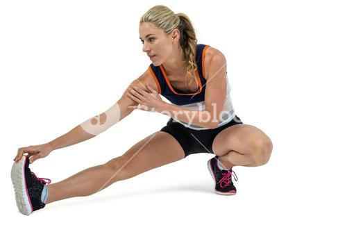 Athletic woman stretching her hamstring