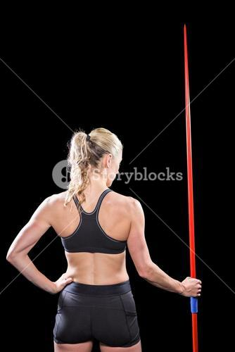 Athlete standing with javelin