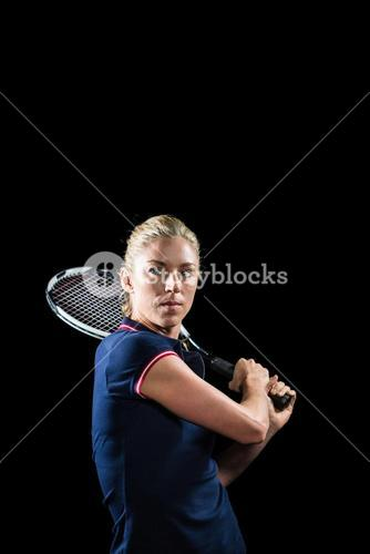 Tennis player playing tennis with a racket