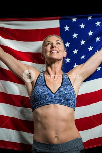 Athlete posing with american flag after victory