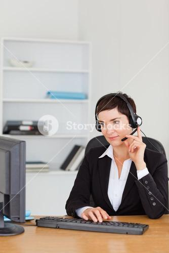 Portrait of a secretary calling with a headset