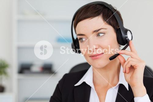 Close up of a secretary calling with a headset