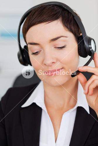 Portrait of a smiling secretary calling with a headset