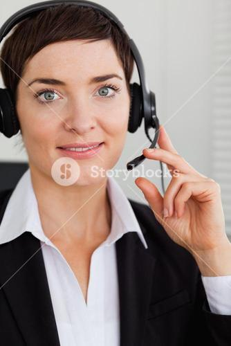 Portrait of a smiling secretary with a headset