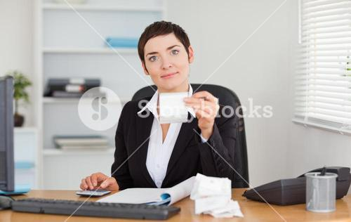 Serious office worker doing accountancy