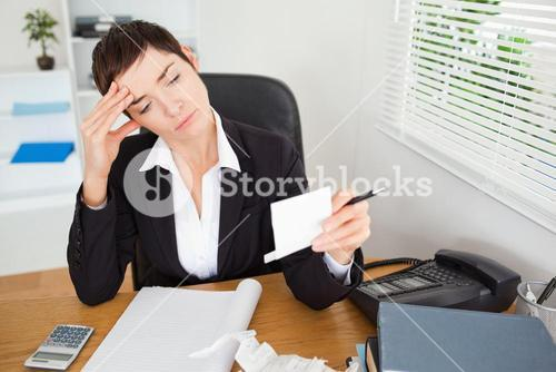 Unhappy accountant checking receipts