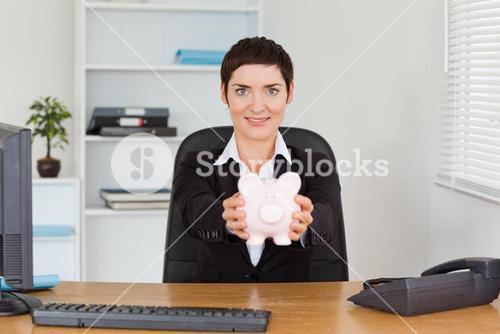 Office worker holding a piggybank