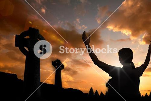 Composite image of woman in casuals with hands raised over white background