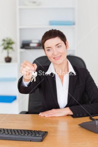 Portrait of an office worker showing keys