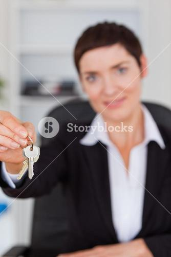 Portrait of a businesswoman showing keys