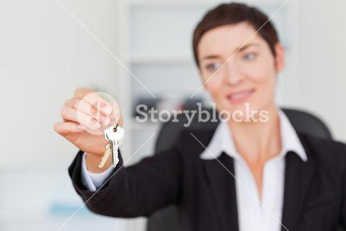 Woman showing keys
