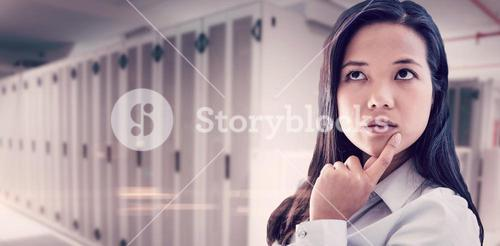 Composite image of thoughtful businesswoman with finger on chin