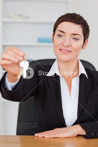 Portrait of a cute secretary showing keys